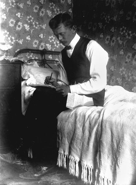 Intimate portrait of a man writing a letter, 1900-1910, John Oxley Library